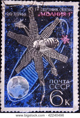 RUSSIA - CIRCA 1966: stamp printed by USSR shows communication satellite
