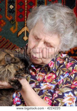 Grandmother With Cat On Her Hands