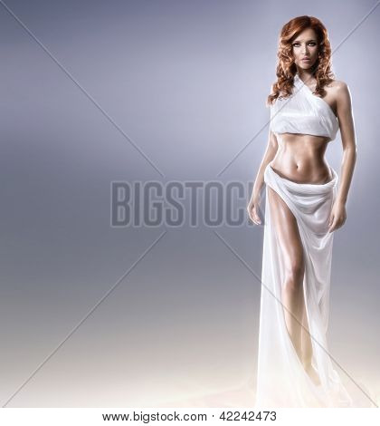 Aphrodite styled young woman over grey background with some blank space