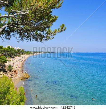 MONT-ROIG DEL CAMP, SPAIN - AUGUST 10: Vacationers in Miami Platja beaches on August 10, 2012 in Mont-roig del Camp, Spain. One of the main attractions of Miami Platja is its 12 km of coastline