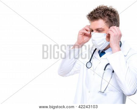Cheerful Doctor Wearing Surgical Mask And Stethoscope
