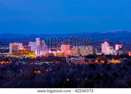 RENO - FEBRUARY 9: Reno skyline on February 9, 2013. It's known as The Biggest Little City in the World, famous for casinos and is the birthplace of the gaming corporation Harrah's Entertainment.