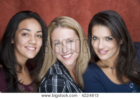 Three Smiling Women