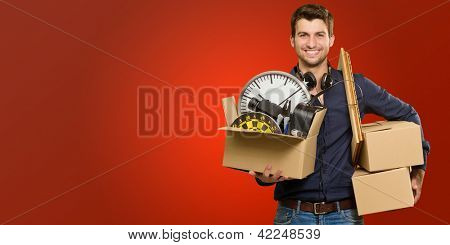 Happy Young Man Holding Cardboxes On Red Background