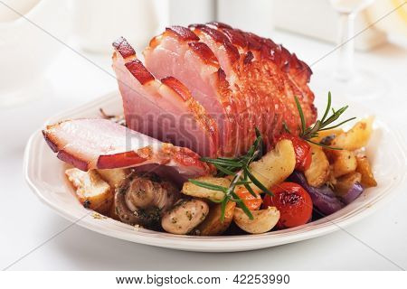 Roasted christmas ham with mushrooms and vegetables