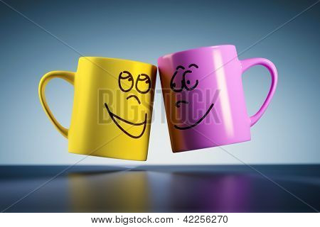 An image of two weightless coffee mugs with faces