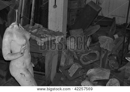 Broken Statue Of Nude Female Figure