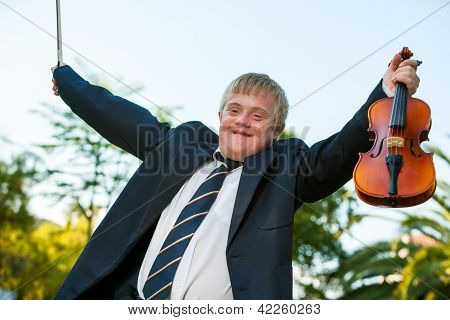 Friendly Handicapped Boy Raising Violin Outdoors.