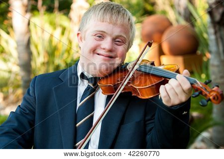 Smiling Handicapped Boy Playing His Violin.