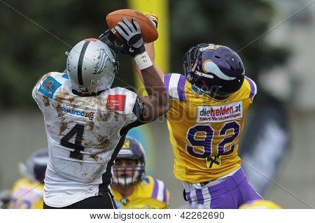 VIENNA, AUSTRIA - APRIL 22 WR Talib Wise (#4 Raiders) and DL Armin Novidi (#92 Vikings) fight for the ball on April 22, 2012 in Vienna, Austria.