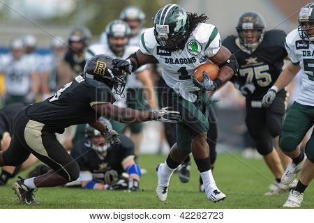 VIENNA, AUSTRIA - APRIL 21 RB Tunde Ogun (#1 Dragons) is tackled by Zacchaeus Mccaskill (#3 Rangers) on April 21, 2012 in Vienna, Austria.
