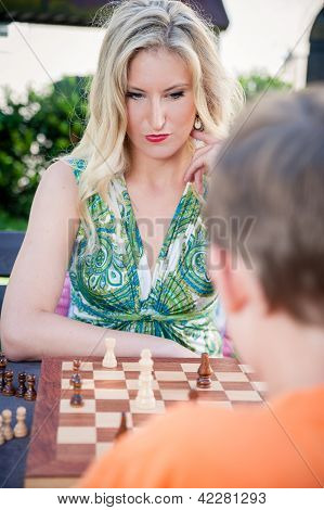 Thinking Woman playing Chess