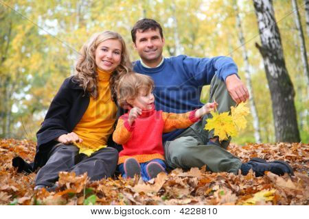 Family With Little Girl In Autumn Park