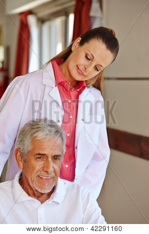 Nurse with senior patient in a wheelchair in a hospital