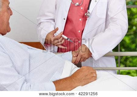 Nurse giving patient in hospital bed a syringe injection in the arm
