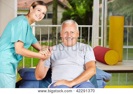 Senior man getting physiotherapy with a physiotherapist