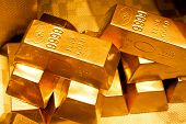 stock photo of billion  - Close up shot of pure gold bars