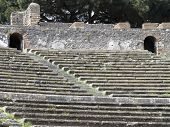 Close-up of grandstand of roman theatre in sunny day