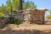 stock photo of mud-hut  - old poor stone hut in the mountains  - JPG