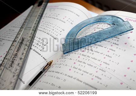 Mathematical Problem - Ruler, Protractor and Pen on Maths Book