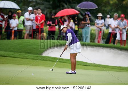 KUALA LUMPUR - OCTOBER 12: Lizette Salas of USA putts at the 2nd hole green of the KLGCC course on Day 3 of the Sime Darby LPGA on October 12, 2013 in Kuala Lumpur, Malaysia.