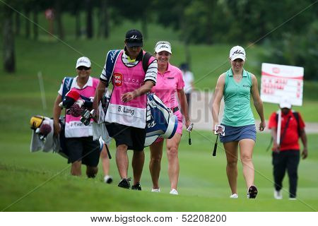 KUALA LUMPUR - OCTOBER 12: Brittany Lang and Jodi E. Shadoff (green) walk to the Hole 2 green of KLGCC course on Day 3 of the Sime Darby LPGA on October 12, 2013 in Kuala Lumpur, Malaysia.