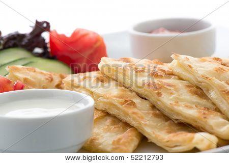 Traditional Turkish flat bread called gozleme isolated on white background