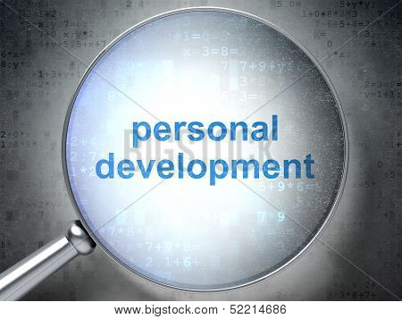 Education concept: Personal Development with optical glass