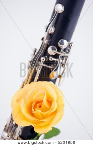 Clarinet With Yellow Rose Isolated On White