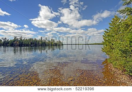 Cloud Reflections On A Clear Lake