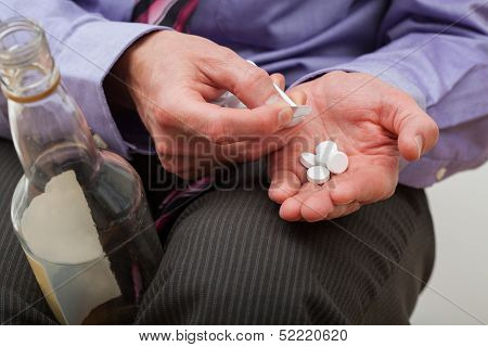 Man With Painkillers And Alcohol