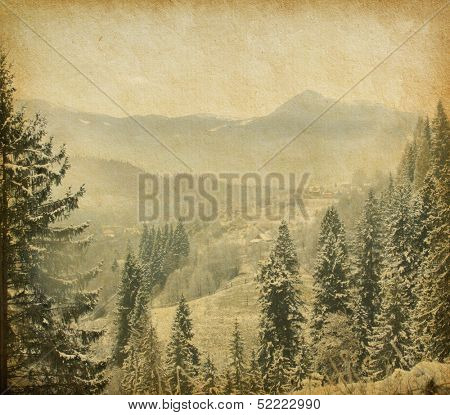 Retro image of winter landscape in the carpathians mountains. vintage paper .