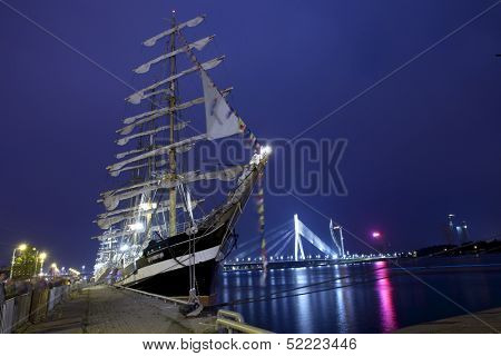 RIGA, LATVIA - JULY 25: Illuminated russian ship Kruzenshtern duringThe tall ships races July25,2013 Riga, Latvia. It is four-masted barque & second largest traditional sailing ship still in operation