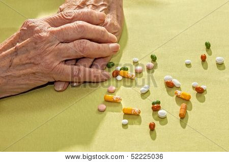 Hands Of An Elderly Lady With Medication