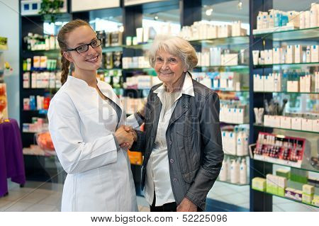Senior Lady Shaking Hands With A Pharmacist