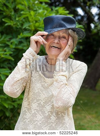 Laughing Elderly Lady Wearing A Hat