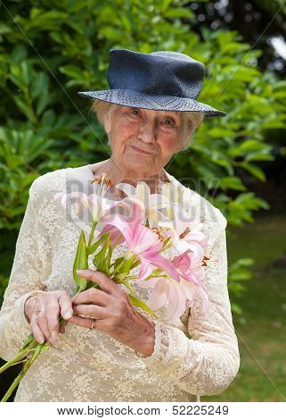 Senior Lady Holding A Bouquet Of Fresh Lilies