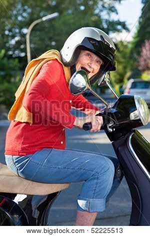 Senior Woman Riding Her Scooter