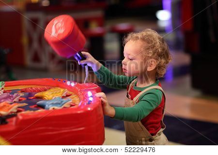 Boy Playing In Amusement