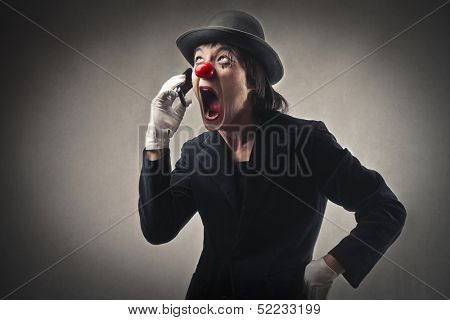 angry clown screaming on the phone