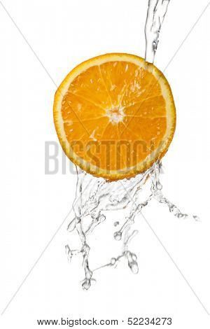water being poured in a orange slice isolated on white