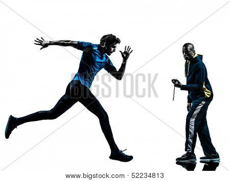 one caucasian man  running sprinting with coach stopwatch in silhouette studio isolated on white background