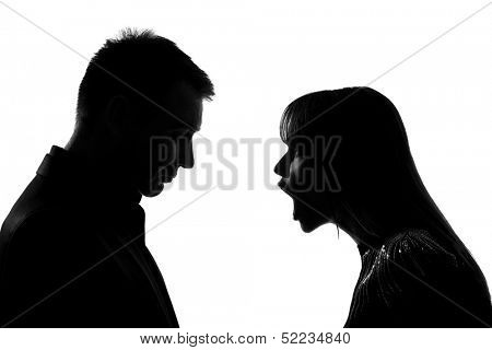 one caucasian couple man and woman face to face screaming shouting dispute in studio silhouette isolated on white background