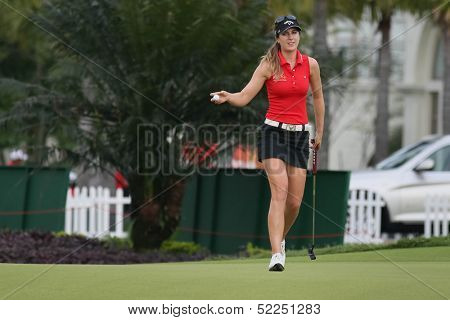 KUALA LUMPUR - OCTOBER 13: Sandra Gal of Germany reacts after a birdie putt at the 2nd hole of the KLGCC course on the final day of the Sime Darby LPGA on October 13, 2013 in Kuala Lumpur, Malaysia.