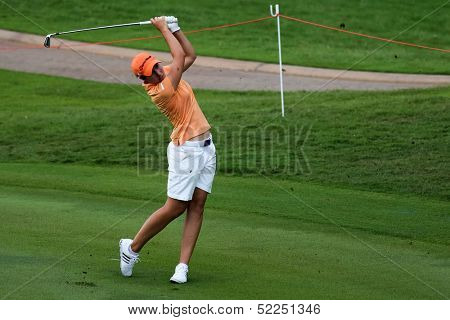 KUALA LUMPUR - OCTOBER 13: Carlota Ciganda of Spain hits the ball to the 2nd hole green of the KLGCC course on the final day of the Sime Darby LPGA on October 13, 2013 in Kuala Lumpur, Malaysia.