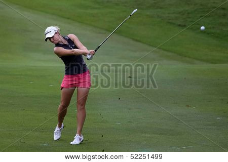 KUALA LUMPUR - OCTOBER 13: Jodi Ewart Shadoff of England hits the ball to the 2nd hole green of the KLGCC course on the final day of the Sime Darby LPGA on October 13, 2013 in Kuala Lumpur, Malaysia.