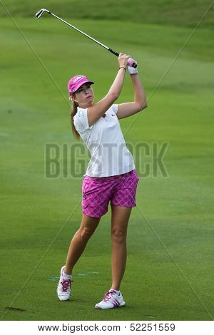 KUALA LUMPUR - OCTOBER 13: Paula Creamer of USA hits the ball to the 2nd hole green of the KLGCC course on the final day of the Sime Darby LPGA on October 13, 2013 in Kuala Lumpur, Malaysia.