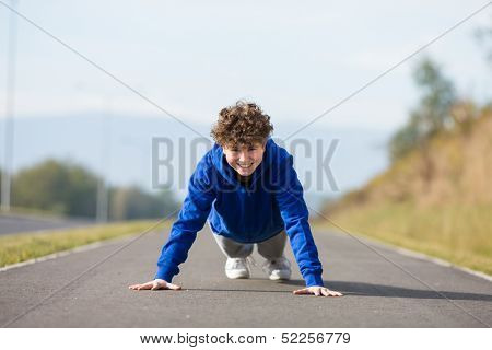 Teenage boy doing push-ups