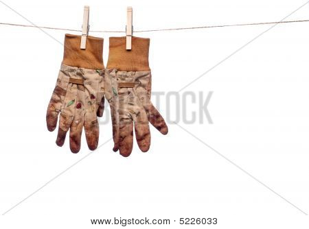 Dirty Garden Work Gloves Hanging On A Clothes Line