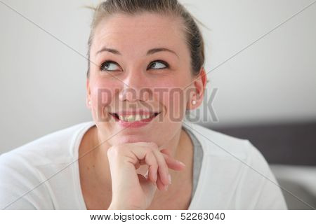 Beautiful Smiling Woman Daydreaming
